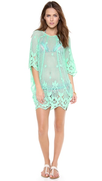 Shop Miguelina online and buy Miguelina Jessica Cover Up Dress Mint - A delicate lace cover up styled with relaxed dolman sleeves and a scalloped hem. Sheer. Fabric: Crochet lace. 100% cotton. Dry clean. Made in the USA. MEASUREMENTS Length: 30in / 76cm, from shoulder. Available sizes: XS
