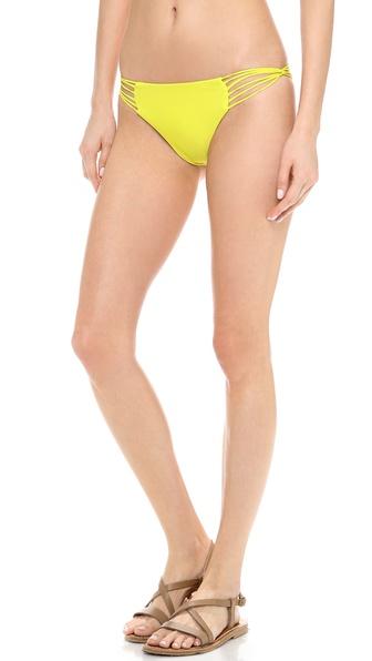 Shop MIKOH SWIMWEAR online and buy Mikoh Swimwear Lanai Bikini Bottoms Starfruit - Looped cutouts reveal flirtatious peeks of skin on solid bikini bottoms by MIKOH SWIMWEAR. Lined. 80% nylon/20% lycra spandex. Hand wash. Imported, Indonesia. Available sizes: L