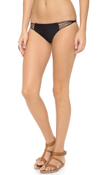 Shop MIKOH SWIMWEAR online and buy Mikoh Swimwear Lanai Bikini Bottoms Night - Looped cutouts reveal flirtatious peeks of skin on solid bikini bottoms by MIKOH SWIMWEAR. Lined. 80% nylon/20% lycra spandex. Hand wash. Imported, Indonesia. Available sizes: L,M,S