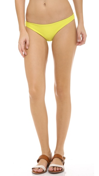 Shop MIKOH SWIMWEAR online and buy Mikoh Swimwear Miyako Bikini Bottoms Starfruit - Solid low rise bikini bottoms from MIKOH SWIMWEAR. Lined. 80% nylon/20% spandex. Hand wash. Imported, Indonesia. Available sizes: L,S,XS