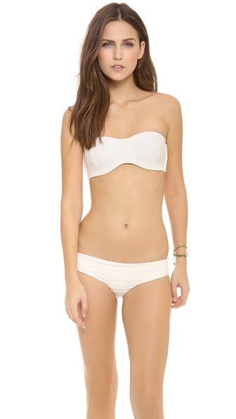 Shop MIKOH SWIMWEAR online and buy Mikoh Swimwear Tulum Bandeau Bikini Top Bone - Boning and padded cups lend structure to a clean lined bandeau bikini top. Lined. 80% polyamide/20% elastane. Hand wash. Imported, Indonesia. Bottoms sold separately. Available sizes: L,M