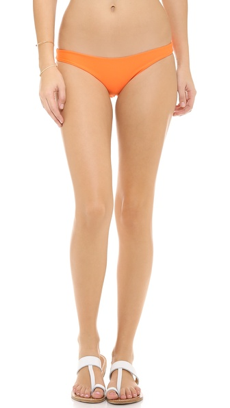 Shop MIKOH SWIMWEAR online and buy Mikoh Swimwear Lahaina Bikini Bottoms Sunrise - Brazilian cut bikini bottoms in a vivid hue. Lined. 80% polyamide/20% elastane. Hand wash. Imported, Indonesia. Available sizes: L