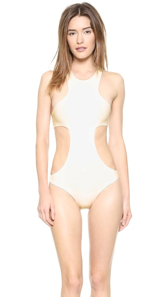Shop MIKOH SWIMWEAR online and buy Mikoh Swimwear Osaka One Piece Swimsuit - Bone - Dramatic cutouts make this one piece swimsuit fun and flirtatious. Racer back. Double layered. 80% nylon/20% spandex. Hand wash. Imported, Indonesia. Size & Fit. Available sizes: L,M,S,XS