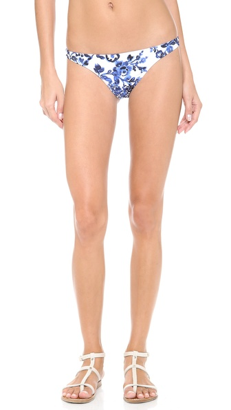 Shop Milly online and buy Milly St. Lucia Bikini Bottoms Fluo Melon - Pretty Milly bikini bottoms in a batik inspired print. Lined. 80% polyamide/20% elastane. Hand wash. Made in the USA of fabric from Italy. Available sizes: P,S