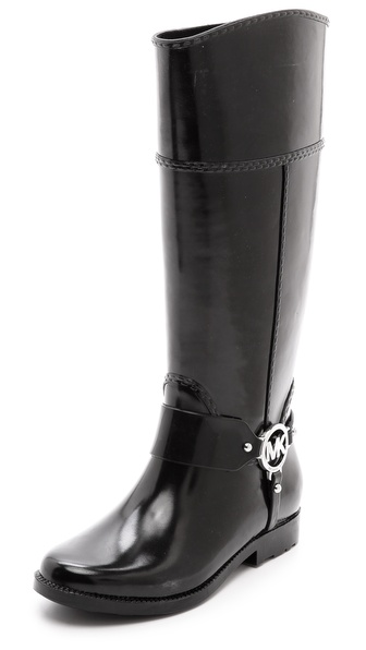 Kupi MICHAEL Michael Kors cipele online i raspordaja za kupiti Rubber MICHAEL Michael Kors rain boots in a sophisticated, riding boot silhouette. Polished logo hardware accents the harness strap, and molded stitches finish the asymmetrical shaft. Lug sole. Fabric: Rubber. Imported, China. This item cannot be gift boxed. Measurements Heel: 0.75in / 20mm Shaft: 14.25in / 36cm Circumference: 14.5in / 37cm. Available sizes: 6,7,8,9,10