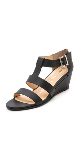 Kupi Nanette Lepore cipele online i raspordaja za kupiti Simple leather Nanette Lepore sandals in a timeless silhouette. Buckled ankle strap. Covered wedge heel and rubber sole.  Leather: Calfskin. Made in the USA. This item cannot be gift-boxed.  MEASUREMENTS Heel: 1.5in / 40mm - Black
