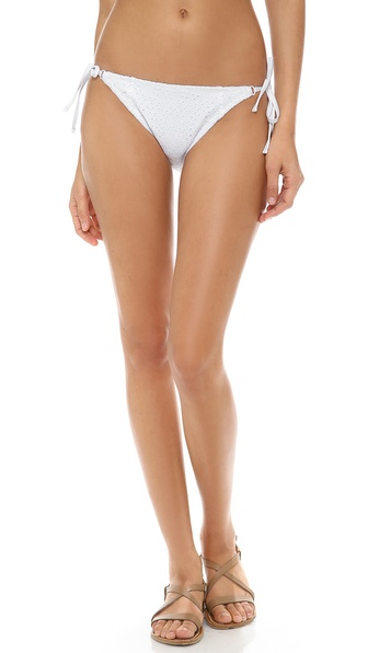 Shop Nanette Lepore online and buy Nanette Lepore Ooh La La Eyelet Bikini Bottoms White - Eyelet embroidery adds a sweet touch to these string bikini bottoms. Lined. 84% nylon/16% elastane. Hand wash. Made in Mexico. Available sizes: L,M,S,XS