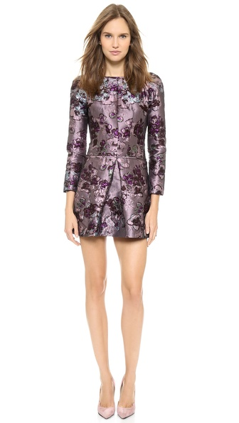 Shop Nina Ricci online and buy Nina Ricci Long Sleeve Dress Lilac Bordeaux - This striking Nina Ricci dress is crafted in rich, metallic brocade, lending ornate charm to the feminine silhouette. Deep pleats sculpt the skirt. Slant hip pockets. The wide neckline dips into a chic V back. Long sleeves. Lined. Fabric: Metallic brocade. 87% polyester/8% silk/5% elastane. Dry clean. Made in France. Measurements Length: 32in / 81cm, from shoulder Measurements from size 38. Available sizes: 34,36,38,40