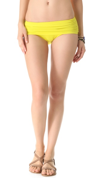 Shop Norma Kamali online and buy Norma Kamali Low Rise Bill Bottoms Acid - These bikini bottoms feature side ruching and a draped overlay. * 80% nylon/20% lycra. * Hand wash. * Made in the USA. * Bikini top sold separately. Available sizes: L,M,S,XS