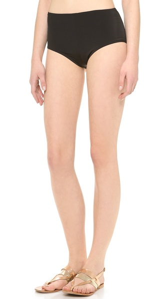 Shop Norma Kamali online and buy Norma Kamali Boy Cut Swim Shorts Black - Norma Kamali bikini bottoms in a boy shorts cut. Lined. 80% nylon/20% elastane. Wash cold. Imported, China. Available sizes: XS