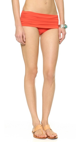 Shop Norma Kamali online and buy Norma Kamali Bill Bikini Bottoms - Persimmon - These mid rise bikini bottoms feature side ruching and a draped overlay. Lined. Shell: 100% polyester. Lining: 80% nylon/20% spandex. Wash cold. Made in the USA. Size & Fit. Available sizes: L,M,S,XS