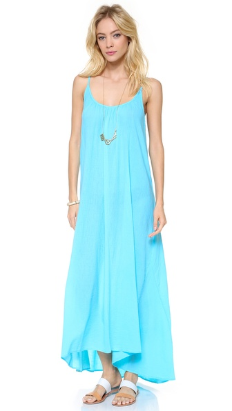 Shop 9seed online and buy 9Seed Tulum Cover Up Dress Caribe - An asymmetrical hem accentuates the flowy dimension of this 9seed cover up. Ruched neckline. Spaghetti straps. Semi sheer. Fabric: Gauze. 100% cotton. Hand wash. Made in the USA. MEASUREMENTS Length: 52in / 132cm, from shoulder. Available sizes: One Size