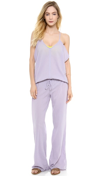 Shop 9seed online and buy 9Seed Amalfi Jumpsuit Abalone - Wide leg pants complement the loose cut bodice of this 9seed jumpsuit. Drawstring waist. Spaghetti straps. Semi sheer. Fabric: Gauze. 100% cotton. Hand wash. Made in the USA. MEASUREMENTS Inseam: 32in / 81cm Leg opening: 20in / 51cm. Available sizes: 1,2