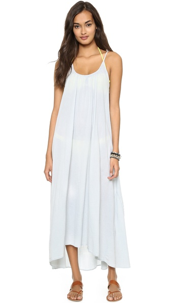 Shop 9seed online and buy 9Seed Tulum Cover Up Mist - A chic, solid chiffon cover up dress with an asymmetrical hem. Semi sheer. Fabric: Crepe. 100% polyester. Hand wash. Made in the USA. Bikini sold separately. MEASUREMENTS Length: 50in / 127cm, from shoulder. Available sizes: One Size