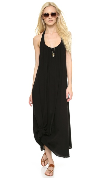 Shop 9seed online and buy 9Seed Antigua Cover Up Dress - Black - A delicate strap skims over the open back of a crinkled gauze 9seed cover up dress, styled with a scoop neckline. Semi sheer. Fabric: Crinkled gauze. Shell: 100% cotton. Hand wash. Made in the USA. Measurements Length: 51.25in / 130cm, from shoulder. Available sizes: One Size