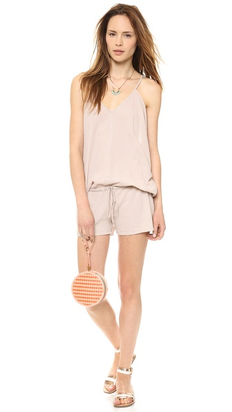 Shop 9seed online and buy 9Seed Corsica Cover Up Romper Sand - A drawstring cinches the loose silhouette of this airy gauze romper. Spaghetti straps. Semi sheer. Fabric: Gauze. 100% cotton. Hand wash. Made in the USA. Measurements Inseam: 2in / 5cm Measurements from size 1. Available sizes: 1,2