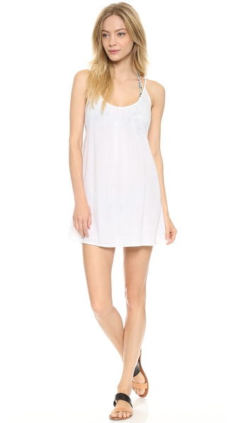 Shop 9seed online and buy 9Seed Nosara Cover Up Dress White - This airy 9seed cover up makes a breezy poolside layer. The spaghetti straps cross at the scoop back. Semi sheer. Fabric: Gauze. 100% cotton. Hand wash. Made in the USA. Measurements Length: 25in / 63.5cm, from shoulder. Available sizes: One Size