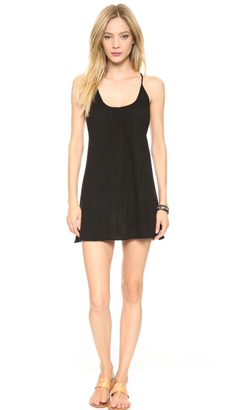 Shop 9seed online and buy 9Seed Nosara Cover Up Dress Black - This airy 9seed cover up makes a breezy poolside layer. The spaghetti straps cross at the scoop back. Semi sheer. Fabric: Gauze. 100% cotton. Hand wash. Made in the USA. Measurements Length: 25in / 63.5cm, from shoulder. Available sizes: One Size