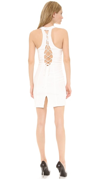 Shop Olcay Gulsen online and buy Olcay Gulsen Bustier Dress White - A daring Olcay Gulsen mini dress in rich double silk crepe. The lace up back panel offers a seductive peek of skin, and a buttoned strap fastens behind the neck. Back slit. Hidden side zip. Lined. Fabric: Double silk crepe. 100% silk. Dry clean. Made in NYC. MEASUREMENTS Length: 32in / 81cm, from shoulder. Available sizes: M,S