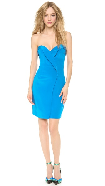 Shop Olcay Gulsen online and buy Olcay Gulsen Strapless Dress - Blue - Rich, vibrant silk composes this alluring Olcay Gulsen cocktail dress. A stitched ruffle trails through the slim bodice, and the sweetheart neckline lends a feminine finish. A split overlay details the skirt. Strapless. Hidden back zip. Lined. Fabric: Double silk crepe. 100% silk. Dry clean. Made in the USA. MEASUREMENTS Length: 26in / 66cm, from center back. Available sizes: M
