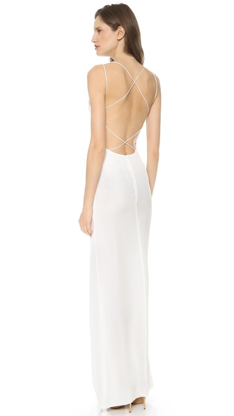 Shop Olcay Gulsen online and buy Olcay Gulsen Crossed Back Maxi Dress - White - Whisper thin straps leave a barely there impression on this silk Olcay Gulsen gown. Crisscross detailing creates a breezy lattice through the low scoop back, and a deep front slit offers an alluring glimpse of leg. Hidden back zip. Unlined. Fabric: Silk georgette. 100% silk. Dry clean. Made in NYC. MEASUREMENTS Length: 60in / 152.5cm, from shoulder. Available sizes: M,S,XS