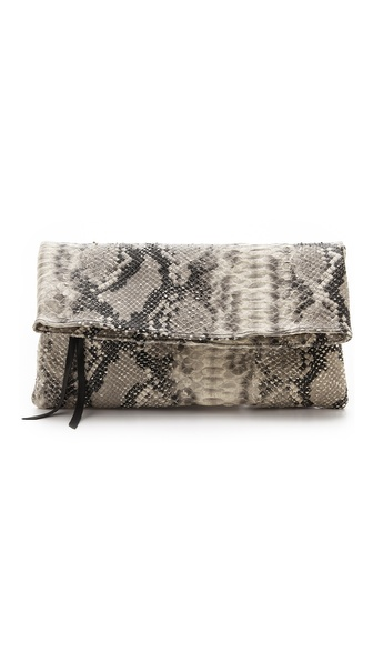 Kupi Oliveve tasnu online i raspordaja za kupiti This embossed, fold over Oliveve clutch makes a daring statement in python print. A tassel pull closes the exterior pocket, and magnetic snaps secure the top. Lined interior. Leather: Cowhide. Weight: 14oz / 0.39kg. Made in the USA. MEASUREMENTS Height: 6in / 15cm, folded Length: 12in / 30.5cm Depth: 1in / 2.5cm. Available sizes: One Size
