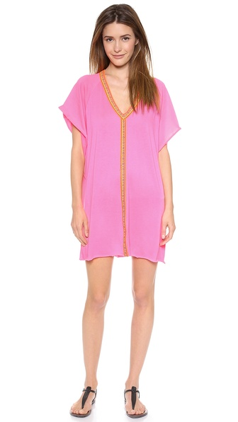 Shop ONE by Pitusa Clothing online and buy One By Pitusa Clothing Inca Mini Abaya Dress Hot Pink - Description Pitusa Clothing , selected for Shopbops ONE by collection for its eclectic look and use of fair trade processes. ONE by is home to exceptional pieces from established and emerging designers. This loose fitting dress drapes effortlessly in soft jersey. Embroidered ribbons trace the V neckline and trim the front. Short raglan sleeves. Raw edges. Unlined. Fabric: Soft jersey. 50% cotton/50% polyester. Hand wash. Made in the USA. Measurements Length: 32in / 81cm, from shoulder. Available sizes: One Size