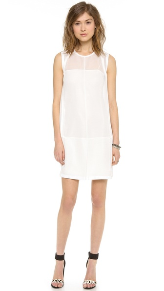 Shop O'2nd online and buy O'2Nd Mesh Tunic Dress Off White - A deep center pleat adds movement to the skirt of a mesh tunic dress. Smooth, coated trim adds a hit of rich texture. Hidden back zip. Slip dress lining. Fabric: Mesh. 97% polyester/3% polyurethane. Dry clean. Imported, Korea. MEASUREMENTS Length: 34in / 86.5cm, from shoulder. Available sizes: 8
