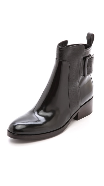Kupi 3.1 Phillip Lim cipele online i raspordaja za kupiti Sleek patent leather gives these edgy 3.1 Phillip Lim boots a streamlined feel, while pebbled leather trim adds a subtle hit of texture. Split, overlapping shaft with enamel buckle closure. Stacked heel. Leather sole. Leather: Cowhide. Imported, China. Measurements Heel: 1.5in / 40mm Shaft: 5in / 13cm. Available sizes: 35,36,36.5,37.5,39,39.5,40