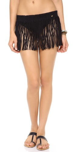 Shop PilyQ online and buy PilyQ Fringe Skirt Cover Up - Playful fringe sways from a cover-up miniskirt, designed with an elasticized macramé waist for an extra touch of texture. Sheer.  78% polyamide/22% elastane. Hand wash. Imported, Colombia.  MEASUREMENTS Length: 10in / 25.5cm - Black