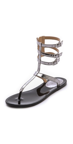 Shop Rachel Zoe online and buy Rachel Zoe Cecille T Strap Sandals - Mirror metallic leather adds a playful touch to strappy Rachel Zoe sandals, styled with a flexible rubber sole. Exposed side zip and buckle closures.  Leather: Kidskin. Imported, China. This item cannot be gift-boxed. - Inox