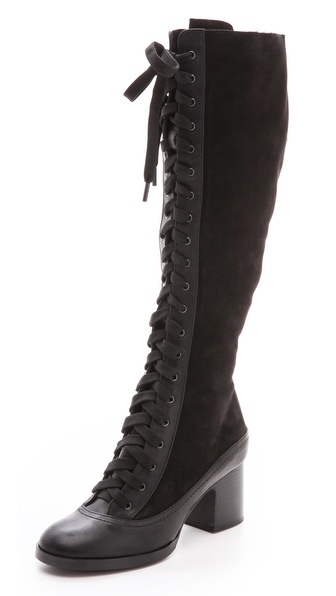 Kupi Rag & Bone cipele online i raspordaja za kupiti Leather and suede knee high Rag & Bone boots offer a nod to Victorian style with a lace up closure and sturdy, stacked heel. Round toe. Exposed side zip. Leather sole. Leather: Cowhide. Made in Italy. This item cannot be gift boxed. Measurements Heel: 2.25in / 60mm Shaft: 16.5in / 42cm Circumference: 14.25in / 36cm. Available sizes: 35,36,36.5,37,37.5,38,38.5,39.5