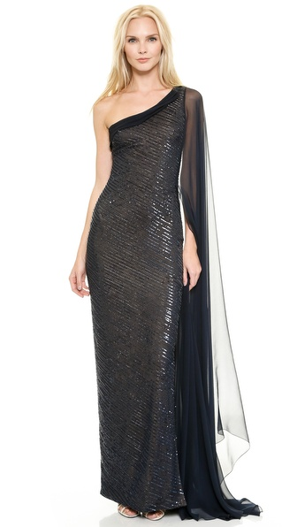 Shop Reem Acra online and buy Reem Acra Embroidered One Shoulder Gown With Chiffon Cape Sleeve Navy - This Reem Acra gown is finished with shimmering beadwork and sequins, giving the one shoulder silhouette a hit of pure glamour. Draped chiffon trims the wide neckline, and a side slit relaxes the floor length skirt. A breezy chiffon overlay drifts to the floor for a striking finish. Hidden back zip. Lined. Fabric: Sequined silk chiffon. 100% silk. Dry clean. Made in the USA. Measurements Length: 63in / 160cm, from shoulder Measurements from size 2. Available sizes: 0,2,4