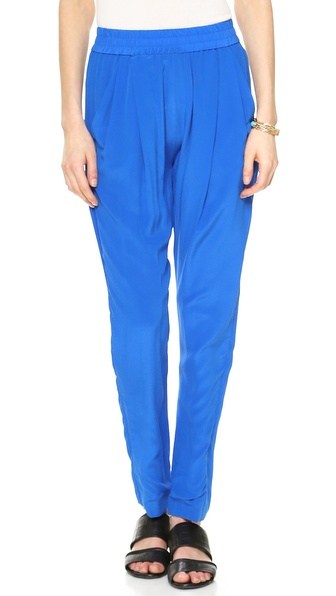 Shop Rhode Resort online and buy Rhode Resort Rohan Pants - Pres Blue - These silk crepe Rhode Resort pants have voluminous pleats below the smocked elastic waist. Slant hip pockets and welt back pockets. Fabric: Silk crepe. Shell: 100% silk. Dry clean. Imported, China. Measurements Rise: 11.75in / 30cm Inseam: 27.5in / 70cm Leg opening: 11.75in / 30cm Measurements from size S. Available sizes: M,S,XS