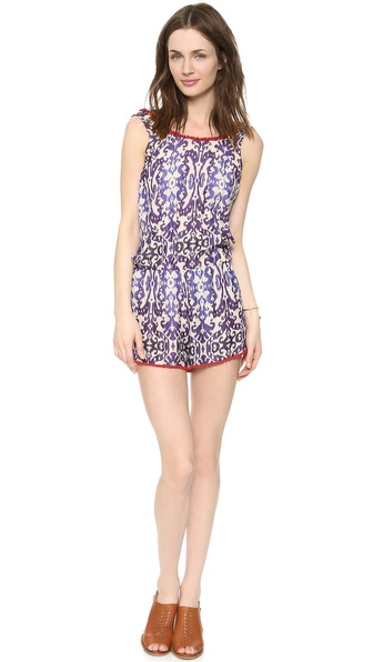 Shop Rhode Resort online and buy Rhode Resort Cy Romper Print - A colorful ikat print and beaded trim lend a bohemian touch to a casual silk gauze romper. Covered elastic defines the waist, and the scoop neckline dips to an open back. Fabric: Silk gauze. Shell: 94% silk/6% polyamide. Dry clean. Imported, India. Measurements Inseam: 3in / 7.5cm Measurements from size S. Available sizes: L,M,S