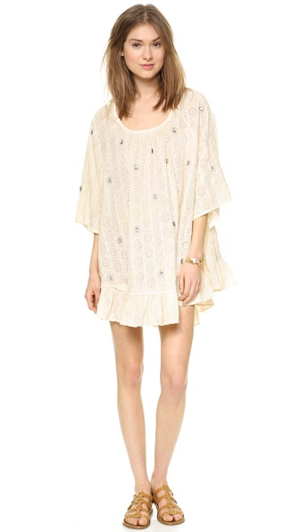 Shop Rhode Resort online and buy Rhode Resort Mai Dress Cream - Shimmering rhinestones punctuate a draped Rhode Resort cover up dress, cut from patterned eyelet. Dolman sleeves accentuate the airy feel, and a ruched ruffle trims the hem. Scoop neckline. Unlined. Fabric: Cotton eyelet. Shell: 100% cotton. Hand wash. Imported, India. Measurements Length: 30in / 76cm, from shoulder Measurements from size XS/S. Available sizes: M/L,XS/S