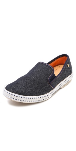 Kupi Rivieras cipele online i raspordaja za kupiti Vintage-inspired, slip-on Rivieras sneakers constructed in cool, dark-wash denim. Inset elastic gores detail the notched top line. Terry lining and textured rubber sole.  Made in Spain. This item cannot be gift-boxed. - Dark Blue Jean