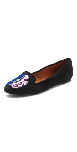Kupi Rebecca Minkoff cipele online i raspordaja za kupiti A hand-embroidered Gemini appliqué details the squared toe of suede Rebecca Minkoff loafers. Notched top line. Rubber sole.  Leather: Kidskin. Imported, China. This item cannot be gift-boxed. - Black