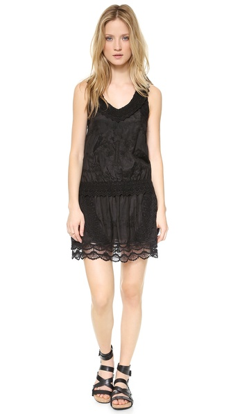 Shop Rebecca Minkoff online and buy Rebecca Minkoff Jenkin Embroidered Racer Back Dress - Black - A tonal '1' appliqu?? gives a nod to sporty style on a racer back Rebecca Minkoff dress. Elaborate crochet trim and embroidery offer vintage appeal, while a casual silhouette keeps the piece easy and modern. Lined. Fabric: Voile. Shell: 65% cotton/35% silk. Lining: 95% polyester/5% elastane. Dry clean. Imported, India. Measurements Length: 35.5in / 90cm, from shoulder Measurements from size 4. Available sizes: 0,2,4,6,8,10,12
