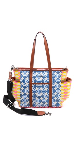 Kupi Rebecca Minkoff tasnu online i raspordaja za kupiti This fluorescent coated canvas baby bag from Rebecca Minkoff is trimmed with neutral wrinkled leather. Magnetic-snap pockets detail the front and back, and patch pockets finish the sides. A detachable tassel hangs from the double handles. Optional, adjustable canvas shoulder strap. The main zip opens to a lined interior with a zip pocket, 7 patch pockets, and a key hook. Changing pad included.  Weight: 40oz / 1.13kg. Imported, China.  MEASUREMENTS Height: 11in / 28cm Length: 13.5in / 34cm Depth: 7in / 18cm Strap drop: 22in / 56cm - Pink/Orange Print