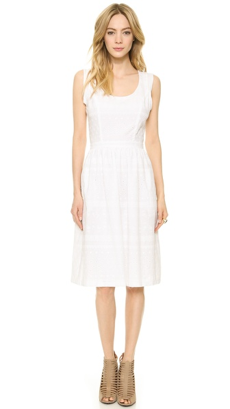 Shop Rebecca Minkoff online and buy Rebecca Minkoff Lela Dress - Chalk - Eyelet embroidery gives this Rebecca Minkoff dress a sweet, feminine look. Ruching lends volume to the skirt, and pockets hide at the sides. Draped panels show a glimpse of skin at the back, which closes with a hidden zip. Lined. Fabric: Cotton eyelet. Shell: 100% cotton. Dry clean. Imported, China. Measurements Length: 39in / 99cm, from shoulder Measurements from size 2. Available sizes: 0,2,4,6,8,10,12