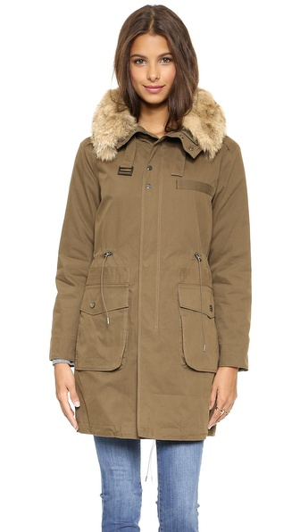 Shop Rebecca Minkoff online and buy Rebecca Minkoff Morris Parka With Fur Collar Army - This military inspired Rebecca Minkoff parka has a fur trimmed hood for a luxe take on cold weather layering. Snaps conceal the zip, and 2 flap pockets detail the front. An internal cord cinches the silhouette for a customized fit. Poly filled. Lined. Fabric: Soft weave. Fur: Natural coyote, from China. Shell: 73% cotton/27% nylon. Lining: 100% polyester. Fill: 100% polyester. Fur clean. Imported, China. Measurements Length: 32.75in / 83cm, from shoulder Measurements from size S THIS ITEM CANNOT BE SHIPPED OUTSIDE THE USA. Available sizes: L,M,S,XS