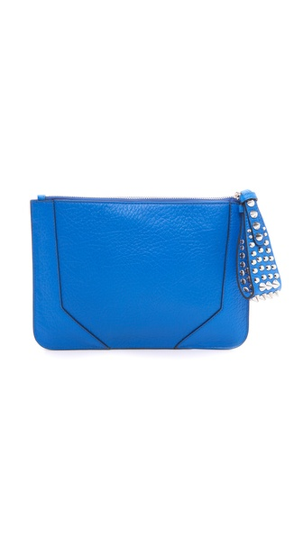 Kupi Rebecca Minkoff tasnu online i raspordaja za kupiti A studded wristlet brings rock and roll edge to this leather Rebecca Minkoff clutch. Sharp seams and a logo stud detail the front. The top zip opens the lined, 4 pocket interior. Dust bag included. Leather: Cowhide. Weight: 20oz / 0.57kg. Imported, China. Measurements Height: 7.75in / 20cm Length: 11in / 28cm. Available sizes: One Size
