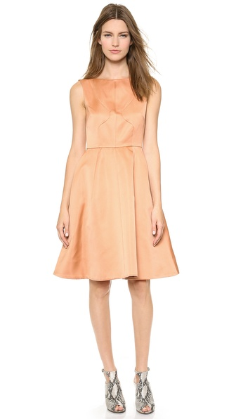 Kupi Rochas haljinu online i raspordaja za kupiti Paneled construction lends a tailored fit to a structured satin Rochas dress. The timeless fit and flare silhouette is styled with a flattering boat neckline and full skirt. On seam hip pockets. Exposed back zip. Lined. Fabric: Satin. 100% polyester. Dry clean. Made in Italy. Measurements Length: 37in / 94cm, from shoulder Measurements from size 40. Available sizes: 38,40,42,44