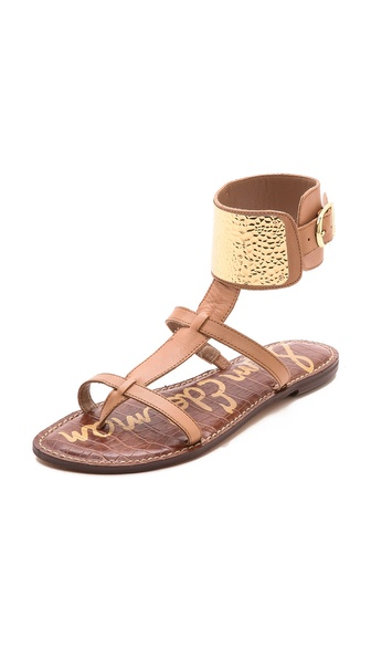 Kupi Sam Edelman cipele online i raspordaja za kupiti A textured metal plate sparkles from the wide ankle cuff of these leather T strap Sam Edelman sandals. Buckle closure. Rubber sole. Leather: Cowhide. Imported, China. This item cannot be gift boxed. Available sizes: 6,6.5,7.5