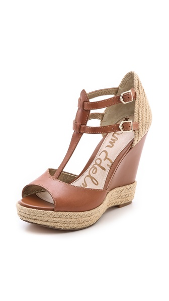 Kupi Sam Edelman cipele online i raspordaja za kupiti Smooth leather complements tactile, braided raffia trim on peep toe Sam Edelman sandals. Buckle ankle straps. Covered wedge platform and rubber sole. Leather: Cowhide. Imported, China. This item cannot be gift boxed. Measurements Heel: 4.25in / 110mm Platform: 1.25in / 30mm. Available sizes: 9,9.5,10
