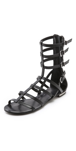 Kupi Schutz cipele online i raspordaja za kupiti Schutz sandals gain structure from slim straps, and metallic patent leather accents the heel. Exposed back zip. Adjustable buckle closures. Leather sole.  Leather: Cowhide. Made in Brazil. This item cannot be gift-boxed. - Black