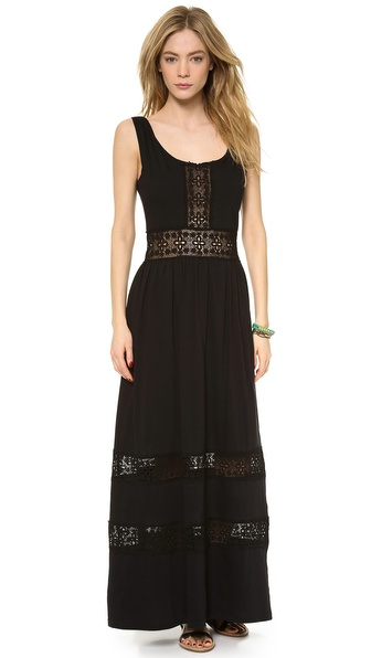 Shop Sea online and buy Sea Long Lace Inset Dress Black - This jersey Sea maxi dress has crocheted lace insets for a casual meets romantic look. Ruching lends volume to the skirt, and the draped bodice crosses in back. Hidden side zip. Miniskirt lining. Fabric: Jersey. Shell: 100% cotton. Trim: 90% nylon/10% cotton. Dry clean. Made in the USA. MEASUREMENTS Length: 56in / 142cm, from shoulder. Available sizes: 0