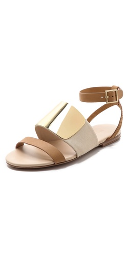 Kupi See by Chloe cipele online i raspordaja za kupiti Simple See by Chloé sandals have a luxe finish with a polished metal plate detailing the wide canvas band. Buckled ankle strap. Leather sole.  Leather: Calfskin. Imported, China. This item cannot be gift-boxed. - Panna