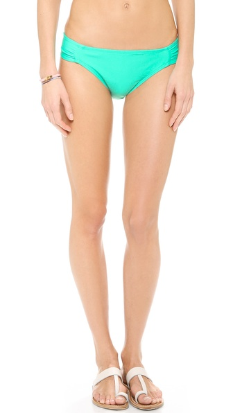 Shop Shoshanna online and buy Shoshanna Caribbean Green Bikini Bottoms Caribbean Green - Bright Shoshanna bikini bottoms, accented with ruching. Lined. Shell: 80% nylon/20% spandex. Lining: 95% polyester/5% spandex. Hand wash. Made in the USA. Available sizes: M,P,S